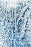 Frosted glass texture. Frost pattern on the window. Abstract blue frost background Stock Photography