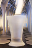Frosted Glasses. Perspective glasses of wine and one shot glass Royalty Free Stock Photography