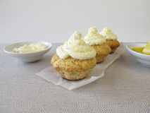 Frosted lemon cupcake Stock Image