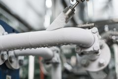 The frosted pipe recuperator. Industrial refrigerating machine Stock Photos