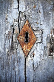 Frosted Rusty Keyhole. Rusting Keyhole on Frosted Blue Door Stock Images