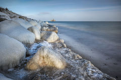 Frosted stones on the sea shore Stock Image