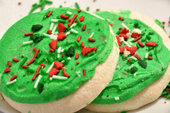 Frosted sugar cookies. Green christmas frosted sugar cookies with sprinkles on white background Royalty Free Stock Photos