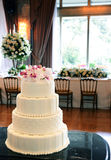 Frosted Wedding Cake with Pearls and Pink Flowers, Dinner Party Royalty Free Stock Images