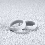 Frosted wedding rings Stock Photography
