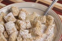 Frosted Wheat Cereal in bowl Royalty Free Stock Image