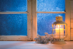 Frosted window with candle for Christmas Royalty Free Stock Image