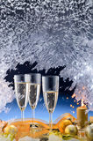 Frosted window and Christmas decoration. Frosted window, champagne glasses and Christmas decoration Royalty Free Stock Photos
