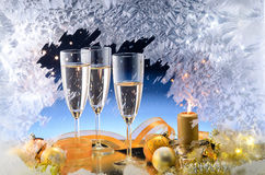 Frosted window and Christmas decoration. Frosted window, champagne glasses and Christmas decoration Stock Images