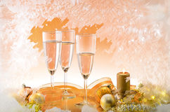 Frosted window and Christmas decoration. Frosted window, champagne glasses and Christmas decoration Royalty Free Stock Photography