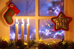 Frosted window with Christmas decoration. Merry Christmas Royalty Free Stock Photos