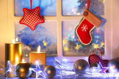 Frosted window with Christmas decoration. Merry Christmas Royalty Free Stock Photo