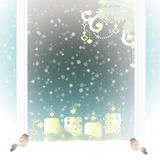 Frosted window with Christmas decoration. Stock Image