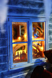 Frosted window with Christmas decorations. And festive lights Royalty Free Stock Image