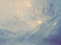 Frosted window. Frost patterns on winter window, cross processing Royalty Free Stock Image