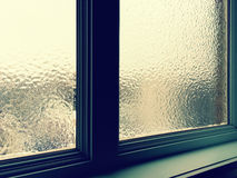 Frosted window pane in winter. Light coming through a frosted window pane in winter Royalty Free Stock Photo