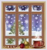 Frosted window and tea cup, winter background Royalty Free Stock Photos