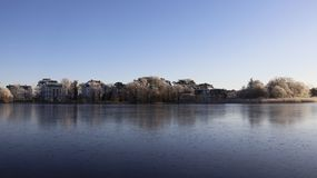 Frostiness in winter. water became ice. Cold winter frosty in sunny day lake became ice with quiet residence in Usedom Island. Germany Stock Images