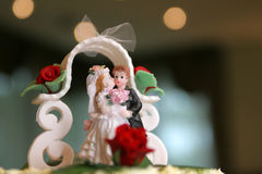 Frosting figurine. A frosting figurine on the top of the wedding  cake Stock Photography