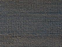 Frostkristaller på träyttersida arkivfoto