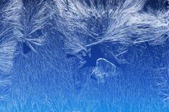Frostmuster auf einem Fensterglas Lizenzfreie Stockfotos