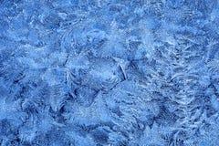 Frostmuster auf Fensterglas im Winter Lizenzfreies Stockfoto