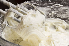 Frosty. Close up of cream cheese frosting mixed up in a glass bowl Royalty Free Stock Photos