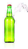 Frosty Beer bottle with water splash isolated Royalty Free Stock Photos