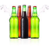 Frosty Beer bottles with water splash. On a white background stock images