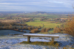 A frosty bench at the top of Crickley Hill. In Gloucestershire Stock Images