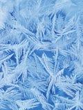 Frosty blue glass. Frosty pattern on the blue glass Royalty Free Stock Photography