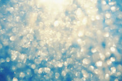 Frosty bokeh glitter sparkle abstract background Stock Images