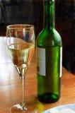 Frosty bottle of white wine stock image