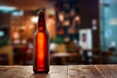 Frosty buttle of light beer. On the bar counter royalty free stock photos