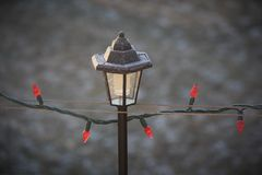 Frosty Christmas lantern. Frost and lights with lantern Royalty Free Stock Photos