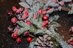 Frosty christmas wreath. A beautiful frosty Christmas wreath of granite, red berries, green leaves and cones Stock Photos