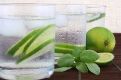 Frosty cold glass. Of ice water with lime Royalty Free Stock Image