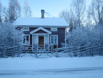 Frosty cold house. An inviting cottage in winter time Royalty Free Stock Images