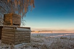 Frosty Crates By The Fields Fotografia Stock Libera da Diritti