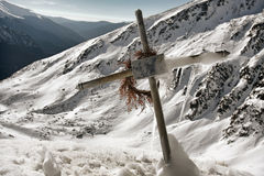 Frosty Cross on Snowy Mountains Stock Photos