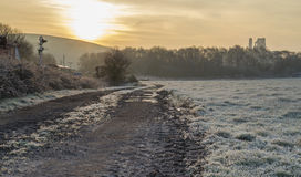 Frosty early morning sun on castle ruin Royalty Free Stock Photography