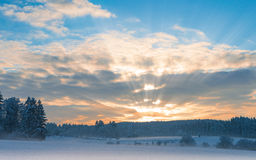 Frosty early morning winter panoramic scenery with rising sun Stock Photo
