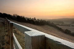 Frosty Fence Landscape. A frost covered fence in the English countryside at dawn Royalty Free Stock Photo