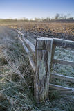 Frosty Gate Post. Close up of frosty gate post with fence running off into the distance Stock Image