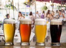 Frosty glass of light beer on the bar counter in the open-air cafe royalty free stock photos