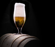 Frosty glass of light beer on black background Royalty Free Stock Image