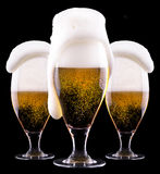 Frosty glass of light beer on black background. Frosty glass of light beer  isolated on a black background Stock Photo
