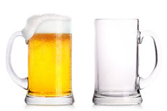Frosty glass of light beer and empty one. Frosty glass of light beer and empty glass isolated on a white background Stock Photo
