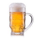 Frosty glass of light beer isolated on a white background royalty free stock photography
