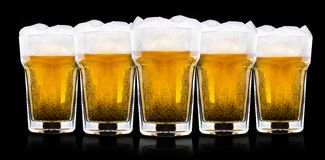 Frosty glass of light beer Stock Photos